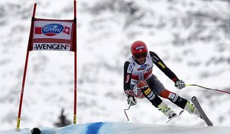 US athlete Bode Miller speeds down the course during the Alpine skiing World Cup downhill race at the Lauberhorn in Wengen, Switzerland, Saturday, Jan. 18, 2014. (AP Photo/Keystone, Peter Schneider)