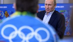 Russian President Vladimir Putin speaks at his meeting with Olympic volunteers in the Black Sea resort of Sochi, Russia, Friday, Jan. 17, 2014. (AP Photo/RIA-Novosti, Alexei Nikolsky, Presidential Press Service)