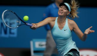Maria Sharapova of Russia hits a forehand return to Alize Cornet of France during their third round match at the Australian Open tennis championship in Melbourne, Australia, Saturday, Jan. 18, 2014.(AP Photo/Aaron Favila)