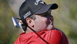 Patrick Reed watches his tee shot on the third hole during the second round of the Humana Challenge golf tournament at the La Quinta Country Club on Friday, Jan. 17, 2014, in La Quinta, Calif. (AP Photo/Chris Carlson)