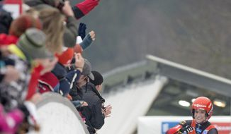 Winner Natalie Geisenberger of Germany celebrates in the ice channel during the women luge World Cup race in Altenberg, eastern Germany, Sunday, Jan. 19, 2014. (AP Photo/Jens Meyer)