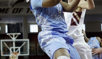 North Carolina guard Brittany Rountree, left, drives toward the basket past Boston College guard Lauren Engeln, right, in the first half of an NCAA college basketball game on Sunday, Jan. 19, 2014, in Boston. (AP Photo/Steven Senne)