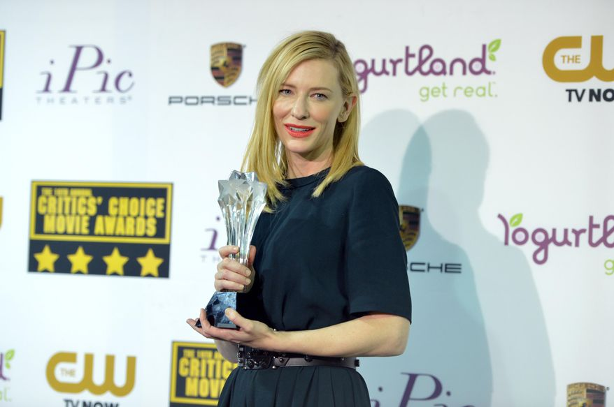 """Cate Blanchett poses with the award for best actress for """"Blue Jasmine"""" in the press room at the 19th annual Critics' Choice Movie Awards at the Barker Hangar on Thursday, Jan. 16, 2014, in Santa Monica, Calif. (Photo by John Shearer/Invision/AP)"""