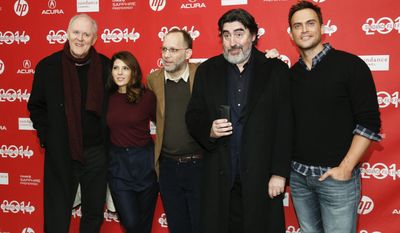 """Writer and director Ira Sachs, third left, poses with cast members from left to right, John Lithgow, Marisa Tomei, Alfred Molina and Cheyenne Jackson as Molina takes a photo of photographers with his mobile phone at the premiere of the film """"Love is Strange"""" during the 2014 Sundance Film Festival, on Saturday, Jan. 18, 2014 in Park City, Utah. (Photo by Danny Moloshok/Invision/AP)"""