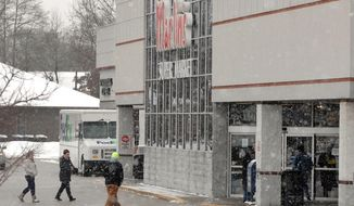 Customers walk toward the front doors of Martin's Super Market in Elkhart, Ind., which reopened at noon on Friday, Jan. 17, 2014. Twenty-year-old Krystle Dikes and 44-year-old shopper Rachelle Godfread were fatally shot at the Elkhart store Wednesday night by gunman who was killed by officers inside the Martin's Super Market, police said. (AP Photo/The Elkhart Truth, Jennifer Shephard)
