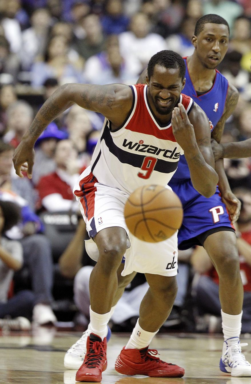 Washington Wizards forward Martell Webster (9) goes for the loose ball with Detroit Pistons guard Kentavious Caldwell-Pope (5) in the first half of an NBA basketball game, Saturday, Jan. 18, 2014, in Washington. (AP Photo/Alex Brandon)