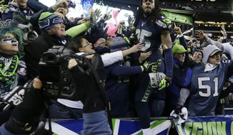 Seattle Seahawks' Richard Sherman celebrates with fans after after the NFL football NFC Championship game against the San Francisco 49ers Sunday, Jan. 19, 2014, in Seattle. The Seahawks won 23-17 to advance to Super Bowl XLVIII. (AP Photo/Elaine Thompson)