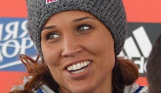 Brakeman Lolo Jones, of the United States looks on during a flower presentation following the women's bobsledding World Cup event Saturday, Dec. 7, 2013, in Park City, Utah. Jones and her pilot Jamie Greubel tied for second place.  (AP Photo/Rick Bowmer)