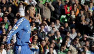 Real Madrid's Cristiano Ronaldo reacts after scoring against Betis during their La Liga soccer match at the Benito Villamarin stadium, in Seville, Spain on Saturday, Jan. 18, 2014. (AP Photo/Angel Fernandez)