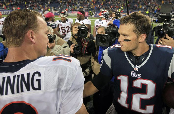 FILE - In this Oct. 7, 2012, file photo, Denver Broncos quarterback Peyton Manning, left, and New England Patriots quarterback Tom Brady, right, speak in the middle of the field after the Patriots beat the Broncos 31-21 in an NFL football game in Foxborough, Mass. The Patriots are scheduled to play the Broncos in the AFC championship game on Sunday in Denver. (AP Photo/Steven Senne, File)