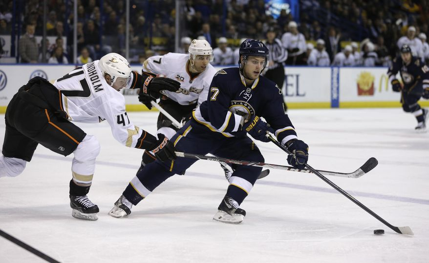 St. Louis Blues' Vladimir Sobotka, right, of the Czech Republic, controls the puck as Anaheim Ducks' Hampus Lindholm, left, of Sweden, and Andrew Cogliano, center, give chase during the second period of an NHL hockey game on Saturday, Jan. 18, 2014, in St. Louis. (AP Photo/Jeff Roberson)