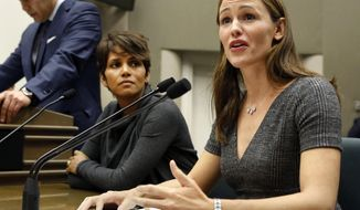 FILE -- In this Aug. 13, 2013 file photo, actress Jennifer Garner, right,  describes how paparazzi aggressively follow her and her three children daily, while she and actress Halle Berry, left, testified  before the Assembly Judiciary Committee in support of a bill that would limit the ability of paparazzi to photograph children of celebrities and public figures, at the Capitol in Sacramento, Calif.  A related measure by Assemblyman Richard Bloom, D-Santa Monica, would amend the civil prohibition on stalking to prohibit surveillance techniques, including staying outside a persons' home, school or work place with no legitimate purpose.  Bloom's measure is one of the hundreds of bills that face an end-of-the-month deadline to pass their house of origin.(AP Photo/Rich Pedroncelli, file)
