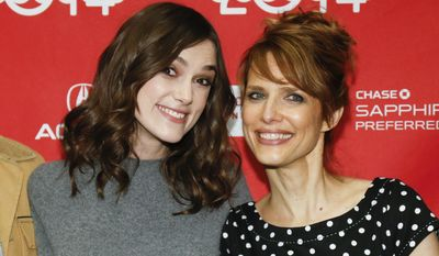 "Cast member Keira Knightley, left, and director Lynn Shelton pose together at the premiere of the film ""Laggies"" during the 2014 Sundance Film Festival, on Friday, Jan. 17, 2014 in Park City, Utah. (Photo by Danny Moloshok/Invision/AP)"