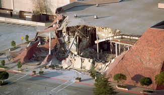 FILE - This Jan. 17, 1994 file photo, shows a portion of the Bullock's department store in the Northridge Fashion Center that collapsed after the Northridge earthquake struck Southern California. The Jan. 17, 1994 Northridge earthquake was felt over a broad area of Southern California, causing widespread death and destruction. While the state has made strides in retrofitting freeways and hospitals, work remains to strengthen concrete buildings and housing with underground parking. (AP Photo/Reed Saxon, File)