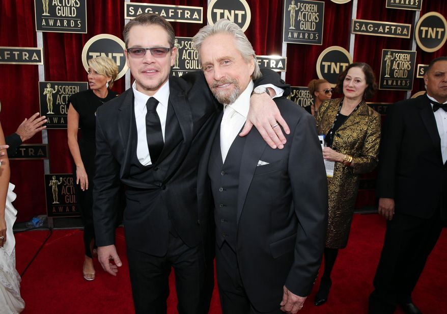Matt Damon and Michael Douglas arrive at the 20th annual Screen Actors Guild Awards at the Shrine Auditorium on Saturday, Jan. 18, 2014, in Los Angeles. (Photo by Matt Sayles/Invision/AP)
