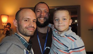 """Tony Milner, left,  Matthew Barraza, center, are shown with their son Jesse. The couple and their son attended a reception Saturday 18, 2014, in celebration of the HBO Documentary """"The Case Against 8."""" The reception also feted several Utah couples like Milner and Barraza who got married late last year after a federal court ruled the state's gay marriage ban unconstitutional. The Supreme Court has ordered a stay of the federal ruling as Utah appeals. (AP Photo/Nekesa Mumbi Moody)"""