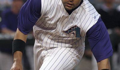 ADVANCE FOR WEEKEND, JAN. 18-19 - FILE - In this May 15, 2006, file photo, Arizona Diamondbacks' Tony Clark starts his head-first slide to score on a hit by Johnny Estrada during a baseball game against the San Diego Padres in Phoenix. Clark has taken over as the head of the baseball players' union, following the death of Michael Weiner. (AP Photo/Roy Dabner, File)
