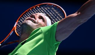 David Ferrer of Spain serves to Florian Mayer of Germany  during their fourth round match at the Australian Open tennis championship in Melbourne, Australia, Sunday, Jan. 19, 2014.(AP Photo/Rick Rycroft)