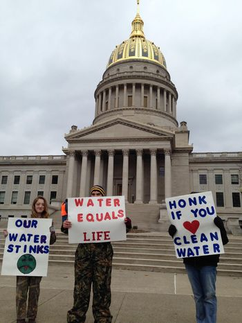 Demonstrators hold signs Saturday, Jan. 18, 2014, at the state Capitol in Charleston, W.Va.  Local residents voiced their concerns about the quality of their tap water after a Jan. 9 chemical spill into the Elk River tainted the water supply. (AP Photo/John Raby)