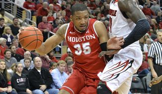 Houston's TaShawn Thomas, attempts to drive under the defense of Louisville's Montrezl Harrell during the first half of an NCAA college basketball game, Thursday, Jan. 16, 2014, in Louisville, Ky. (AP Photo/Timothy D. Easley)