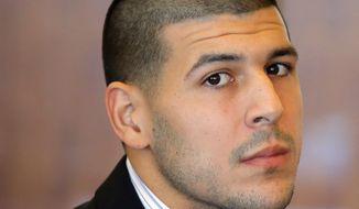 "FILE - In this Oct. 9, 2013, file photo, former New England Patriots NFL football player Aaron Hernandez attends a pretrial court hearing in Fall River, Mass. Hernandez has pleaded not guilty to killing Odin Lloyd, 27, a semi-professional football player from Boston who was dating the sister of Hernandez's girlfriend. Police wrote in a June 28, 2013 search warrant application that there was probable cause to believe that Hernandez was driving a vehicle used in a separate double slaying of Daniel Jorge Correia de Abreu and Safiro Teixeira Furtado, in Boston, and ""may have been the shooter."" (AP Photo/Brian Snyder, Pool, File)"