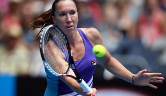 Jelena Jankovic of Serbia makes a forehand return to Kurumi Nara of Japan during their third round match at the Australian Open tennis championship in Melbourne, Australia, Saturday, Jan. 18, 2014.(AP Photo/Rick Rycroft)