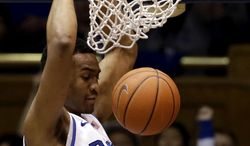 Duke's Jabari Parker dunks against North Carolina State during the first half of an NCAA college basketball game in Durham, N.C., Saturday, Jan. 18, 2014. (AP Photo/Gerry Broome)