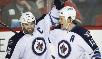 Winnipeg Jets' Olli Jokinen, right, from Finland, celebrates his goal with teammate Andrew Ladd during second period NHL hockey action against the Calgary Flames in Calgary, Canada, Thursday, Jan. 16, 2014. (AP Photo/The Canadian Press, Jeff McIntosh)