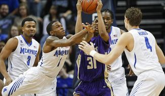LeMoyne-Owen forward Victor Shell (31) tries to hang onto the ball against Memphis defenders Chris Crawford (3), Joe Jackson (1), Shaq Goodwin, back, and Austin Nichols (4) in the first half of an NCAA college basketball game Saturday, Jan. 18, 2014, in Memphis, Tenn. (AP Photo/Lance Murphey)