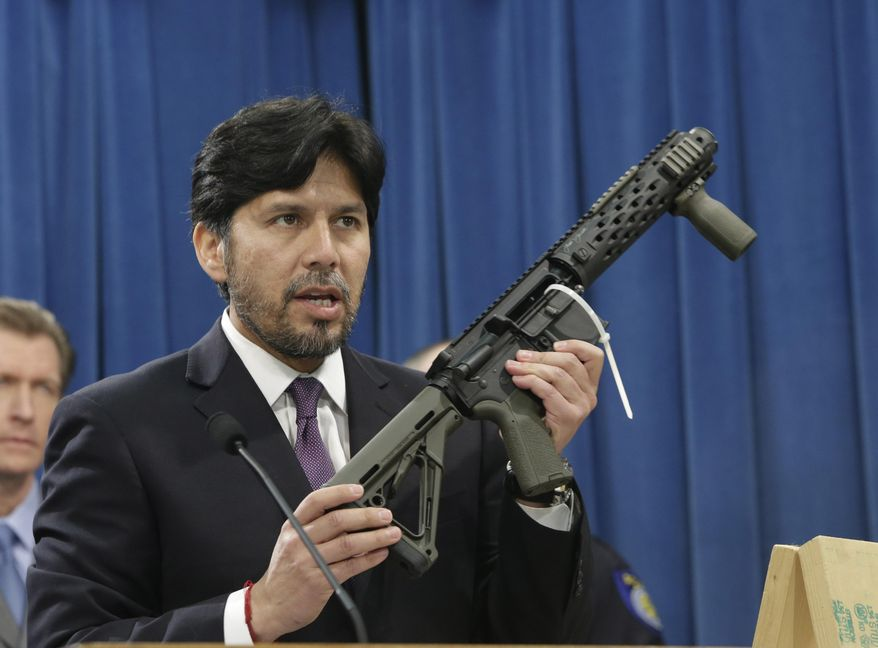 """FILE -- In this Jan. 13, 2014 file photo, State Sen. Kevin de Leon, D-Los Angeles, displays a homemade fully automatic rifle, confiscated by the Department of Justice, as he discusses his proposed legislation dealing with """"ghost guns,""""  at the Capitol in Sacramento, Calif., Monday, Jan. 13, 2014.  De Leon's SB808 would allow the manufacture or assembly of homemade weapons, known as """"ghost guns,"""", but require the makers to first apply to the state Department of Justice for a serial number that would be given only after the applicants undergo a background check.  De Leon's measure is one of the hundreds of bills that face an end-of-the-month deadline. to pass their house of origin.(AP Photo/Rich Pedroncelli, file)"""