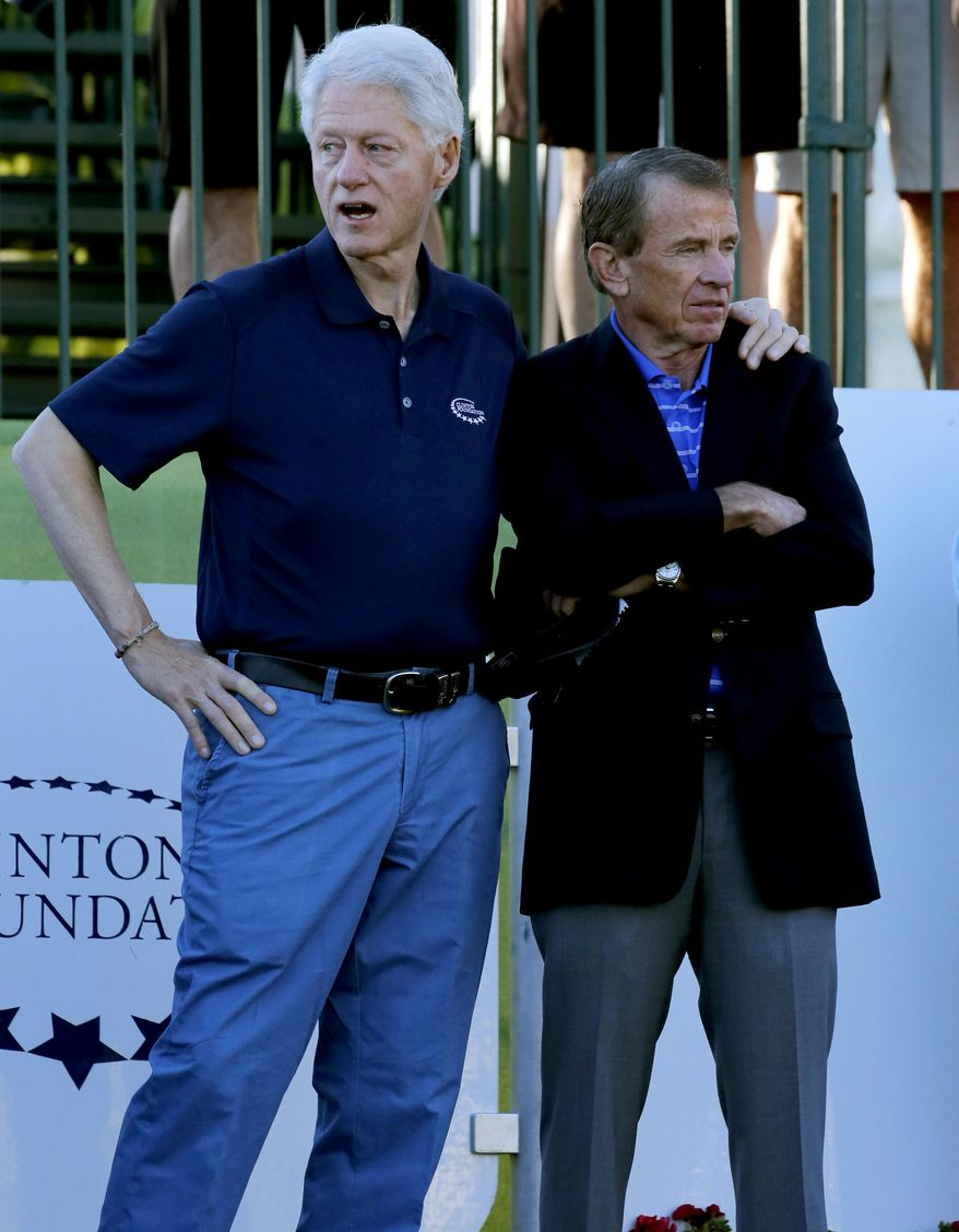 Former President Bill Clinton, left, stands with PGA Tour Commissioner Tim Finchem prior to the start of the first round of the Humana Challenge PGA golf tournament on the Palmer Private course at PGA West, Thursday, Jan. 16, 2014, in La Quinta, Calif.  (AP Photo/Matt York)