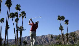 Robert Garrigus watches his tee shot on the 18th hole during the first round of the Humana Challenge golf tournament at the La Quinta Country Club on Thursday, Jan. 16, 2014 in La Quinta, Calif. (AP Photo/Chris Carlson)