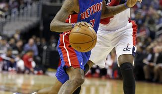 Detroit Pistons guard Brandon Jennings (7) gets past Washington Wizards guard John Wall (2) in the first half of an NBA basketball game, Saturday, Jan. 18, 2014, in Washington. (AP Photo/Alex Brandon)