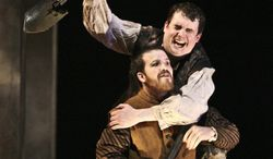 "This image released by The Acting Company shows Grant Fletcher Prewitt and Ian Gould in ""Rosencrantz and Guildenstern Are Dead."" The tells the absurdist story of the Danish Prince's childhood friends, who are sent to spy on Hamlet and end up as confused courtiers navigating the shark-infested waters of the royal court. (AP Photo/The Acting Company, Michael Lamont)"