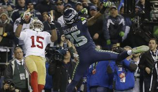 Seattle Seahawks' Richard Sherman tips a pass intended for San Francisco 49ers' Michael Crabtree (15) in the final seconds of the second half of the NFL football NFC Championship game Sunday, Jan. 19, 2014, in Seattle. Malcolm Smith intercepted the tipped pass. The Seahawks won 23-17 to advance to Super Bowl XLVIII. (AP Photo/Marcio Jose Sanchez)