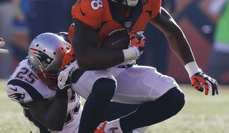 Denver Broncos wide receiver Demaryius Thomas (88) is dragged to the ground by New England Patriots cornerback Kyle Arrington (25) during the second half of the AFC Championship NFL playoff football game in Denver, Sunday, Jan. 19, 2014. (AP Photo/Julie Jacobson)