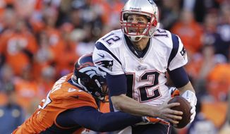 New England Patriots quarterback Tom Brady (12) is sacked by Denver Broncos defensive end Jeremy Mincey (57) during the second half of the AFC Championship NFL playoff football game in Denver, Sunday, Jan. 19, 2014. (AP Photo/Joe Mahoney)