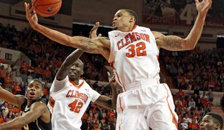 Clemson's K.J. McDaniels grabs a rebound during the second half of an NCAA college basketball game against Wake Forest in Clemson, S.C., on Saturday, Jan. 18, 2014. (AP Photo/The Independent-Mail, Mark Crammer) THE GREENVILLE NEWS OUT, SENECA NEWS OUT