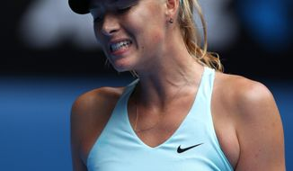 Maria Sharapova of Russia celebrates a point won against Dominika Cibulkova of Slovakia during their fourth round match at the Australian Open tennis championship in Melbourne, Australia, Monday, Jan. 20, 2014.(AP Photo/Aaron Favila)