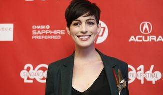 "Cast member Anne Hathaway poses at the premiere of the film ""Song One"" during the 2014 Sundance Film Festival, on Monday, Jan. 20, 2014, in Park City, Utah. (Photo by Danny Moloshok/Invision/AP)"