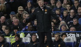 Manchester United's manager David Moyes lifts his arms as he watches his side play Chelsea during the English Premier League soccer match between Chelsea and Manchester United at Stamford Bridge stadium in London, Sunday, Jan. 19, 2014. (AP Photo/Matt Dunham)