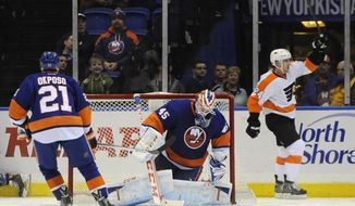 Philadelphia Flyers' Matt Read (24) celebrates his goal against New York Islanders goalie Anders Nilsson (45) in the second period of an NHL hockey game on Monday, Jan. 20, 2014, in Uniondale, N.Y. (AP Photo/Kathy Kmonicek)