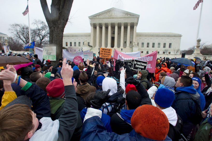 Pro-life and pro-choice activists face off in front of the Supreme Court on the anniversary of the Roe v. Wade ruling that legalized abortion nationwide. The March for Life and raging debate have continued for more than 40 years with no end in sight. (Associated Press)