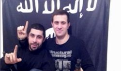 In this image made from a video posted online by an Islamic militant group asserting responsibility for suicide bombings last month that killed 34 people in Volgograd, Russia, two men, identified as Suleiman and Abdurakhman and who purportedly carried out the twin suicide bombings are seen at an unknown location. The two Russian-speaking men featured in the video are identified as members of Ansar al-Sunna, the name of a militant group operating in Iraq. It was unclear whether they had received funding or training from the group or only adopted its name. (AP Photo)