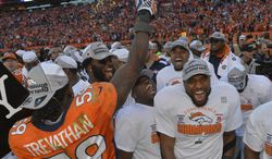 The Denver Broncos celebrate after the AFC Championship NFL playoff football game against the New England Patriots in Denver, Sunday, Jan. 19, 2014. The Broncos defeated the Patriots 26-16 to advance to the Super Bowl. (AP Photo/Jack Dempsey)