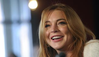 """Actress Lindsay Lohan addresses reporters during a news conference at the 2014 Sundance Film Festival, Monday, Jan. 20, 2014, in Park City, Utah. Producer Randall Emmett and Lohan announced the forthcoming production of a new film, """"Inconceivable,"""" in which Lohan will star and co-produce. (Photo by Chris Pizzello/Invision/AP)"""