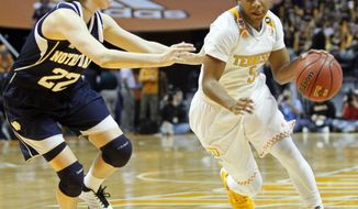 Tennessee guard Ariel Massengale (5) drives against Notre Dame guard Madison Cable (22) in the first half of an NCAA college basketball game Monday, Jan. 20, 2014, in Knoxville, Tenn. (AP Photo/Wade Payne)