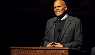 Activist and entertainer Harry Belafonte gives the keynote address for the Rev. Dr. Martin Luther King Jr. Symposium at Hill Auditorium on the University of Michigan campus in Ann Arbor, Mich., for Martin Luther King Jr. Day, on Monday, Jan. 20, 2014. (AP Photo/The Ann Arbor News, Melanie Maxwell)