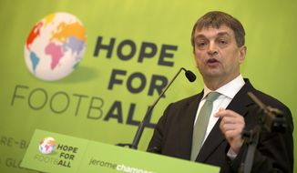 Jerome Champagne  announces his intention to stand for FIFA president in 2015, in London Monday, Jan  20  2014. But Champagne hinted that he might abandon his challenge if Sepp Blatter stands for a fifth term. Champagne, a Frenchman who is a former Blatter adviser, on Monday became the first person to declare his candidacy for world football's top job, saying he will seek the five required nominations .(AP Photo/Alastair Grant)