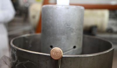 This picture released by Islamic Republic News Agency, IRNA, shows an International Atomic Energy Agency (IAEA) seal on a piece of equipment at one of Iran's uranium enrichment facilities at the Natanz plant, some 200 miles (322 kilometers) south of the capital Tehran, Iran, Monday, Jan. 20, 2014. Iran has halted its most sensitive uranium enrichment work as part of a landmark deal struck with world powers, state TV said Monday. The broadcast said Iran halted its 20 percent uranium enrichment, which is just steps away from bomb-making materials, by cutting the link feeding cascades enriching uranium in Natanz. (AP Photo/IRNA, Kazem Ghane)